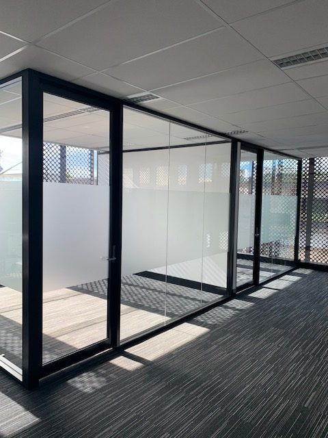 Glass wall partition and grid ceilings